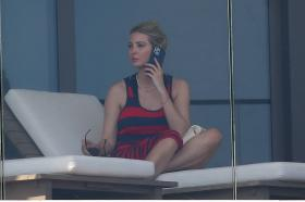 ivanka-trump-in-a-red-and-black-striped-dress-on-her-balcony-in-miami-02.jpg