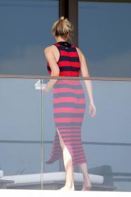 ivanka-trump-in-a-red-and-black-striped-dress-on-her-balcony-in-miami-03.jpg