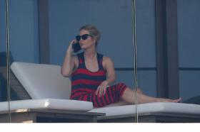 ivanka-trump-in-a-red-and-black-striped-dress-on-her-balcony-in-miami-04.jpg
