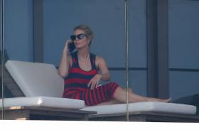 ivanka-trump-in-a-red-and-black-striped-dress-on-her-balcony-in-miami-06.jpg