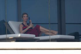 ivanka-trump-in-a-red-and-black-striped-dress-on-her-balcony-in-miami-07.jpg