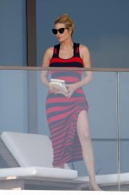 ivanka-trump-in-a-red-and-black-striped-dress-on-her-balcony-in-miami-11.jpg