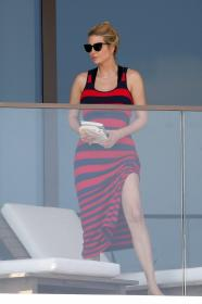 ivanka-trump-in-a-red-and-black-striped-dress-on-her-balcony-in-miami-15.jpg