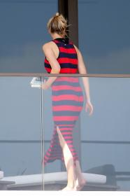 ivanka-trump-in-a-red-and-black-striped-dress-on-her-balcony-in-miami-18.jpg