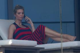 ivanka-trump-in-a-red-and-black-striped-dress-on-her-balcony-in-miami-20.jpg