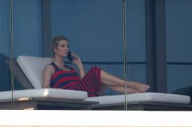 ivanka-trump-in-a-red-and-black-striped-dress-on-her-balcony-in-miami-22.jpg