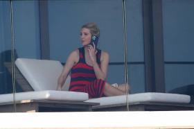 ivanka-trump-in-a-red-and-black-striped-dress-on-her-balcony-in-miami-23.jpg