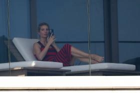ivanka-trump-in-a-red-and-black-striped-dress-on-her-balcony-in-miami-28.jpg