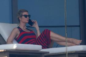 ivanka-trump-in-a-red-and-black-striped-dress-on-her-balcony-in-miami-29.jpg