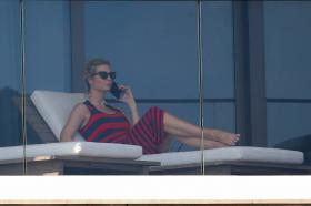 ivanka-trump-in-a-red-and-black-striped-dress-on-her-balcony-in-miami-31.jpg