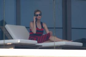 ivanka-trump-in-a-red-and-black-striped-dress-on-her-balcony-in-miami-33.jpg