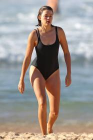 victoria-lee-in-a-black-one-piece-swimsuit-at-the-beach-in-sydney-wearing-02.jpg