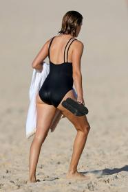 victoria-lee-in-a-black-one-piece-swimsuit-at-the-beach-in-sydney-wearing-04.jpg