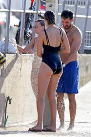 victoria-lee-in-a-black-one-piece-swimsuit-at-the-beach-in-sydney-wearing-14.jpg
