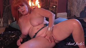 auntjudys-20-12-24-melanie-lingerie-and-robe-fireside-masturbation.jpg